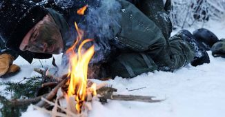Starting a fire to prevent hypothermia