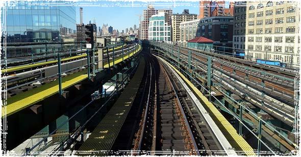 Train Tracks running through downtown city