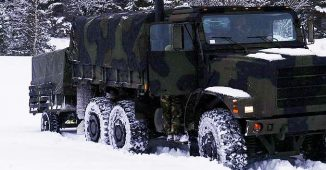 Big Truck driving in the Snow