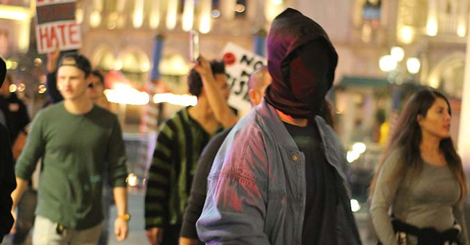 Activists in masks trying to start a riot