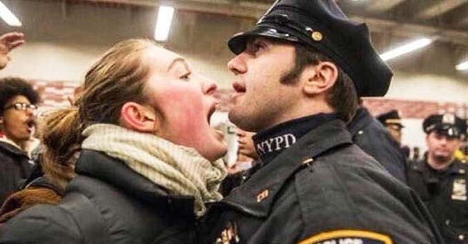 Female Protestor Shouting at a Police Officer