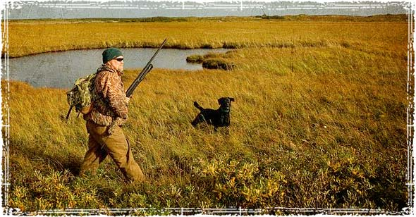 Hunter out hunting with his dog
