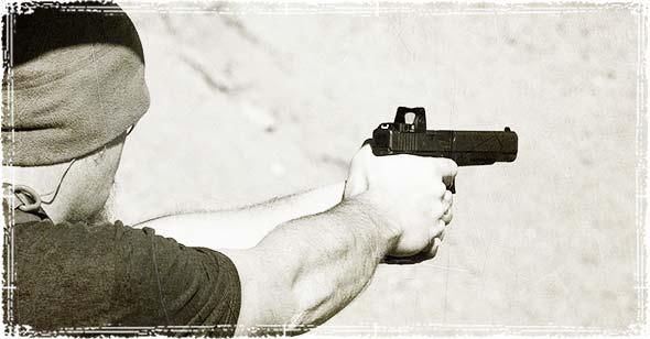 Guy Holding a Gun
