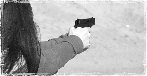 Woman holding a firearm in self-defense
