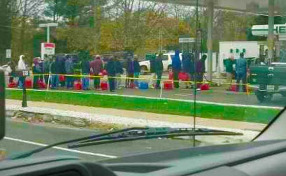 People Standing in Line for Gas