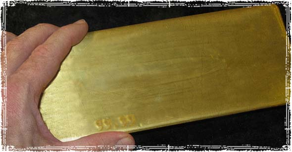 Guy Holding Gold Bar