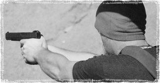 Guy shootinga handgun