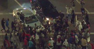 Mob Smashing Cars