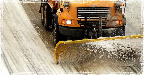 Snow Plow Plowing Highway During Snow Storm