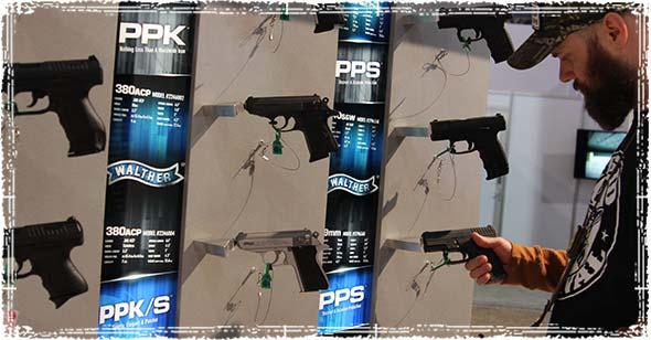 looking at handguns during the SHOT Show
