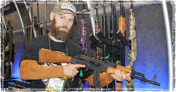 Holding a AK47 style rifle