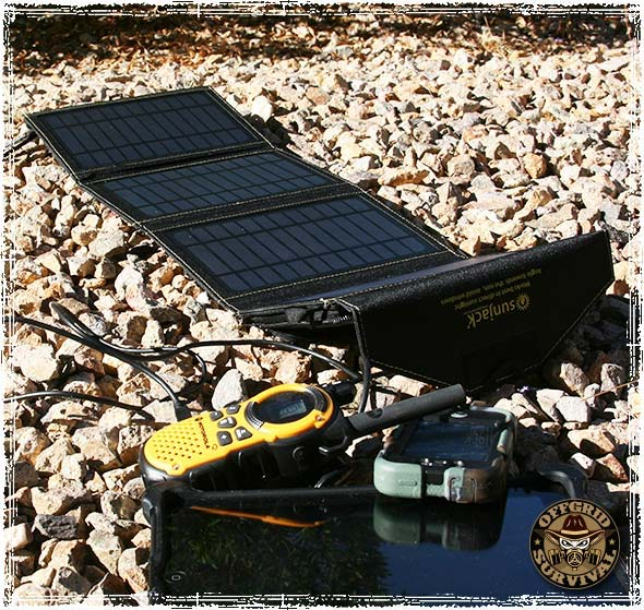 SunJack Solar Charger charging a Radio and an iPad