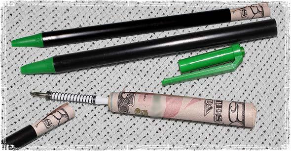 $50 bill rolled up inside a pen