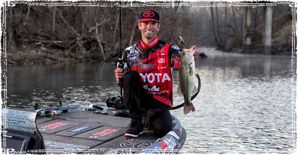 Pro Angler Mike Iaconelli holding a Fish he just Caught