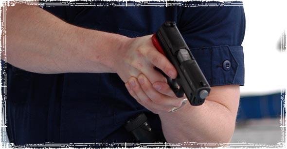 Holding Firearm