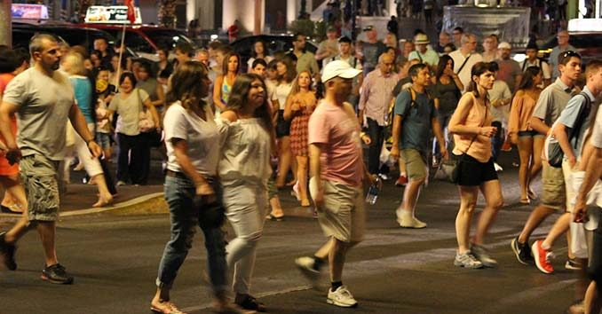 A bunch of people walking on a street unaware of what's going on around them