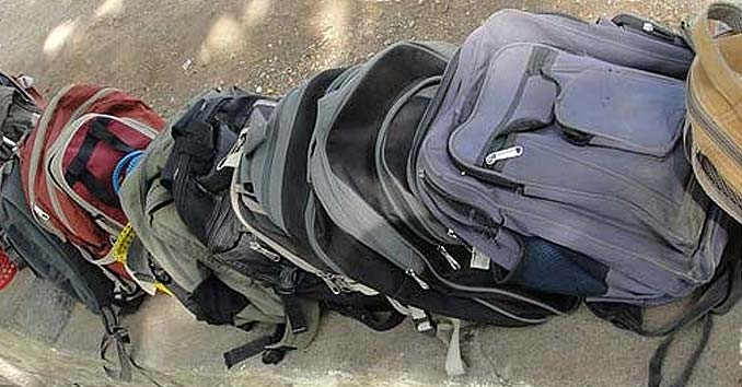 Backpacks outside of a school