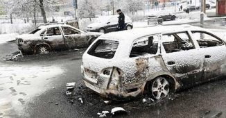 Burnt vehicle from riots in Rinkeby, Sweden