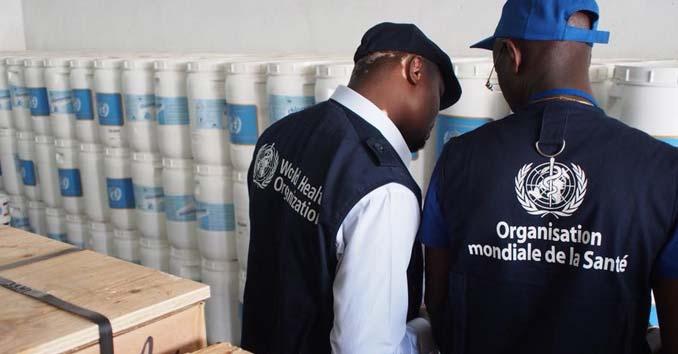 World Health Organization Workers Bringing in Antibiotics