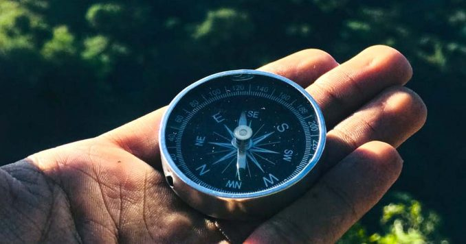 Guy holding a compass