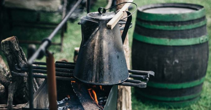Boiling Water with Water Storage Barrel in the Background