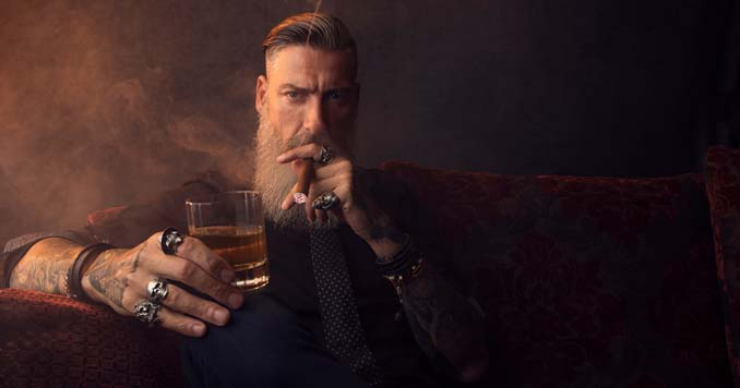 Guy drinking whiskey