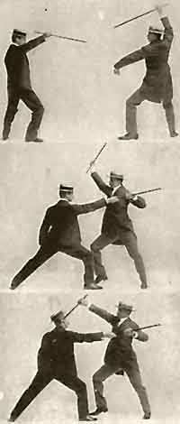 2 guys fighting with a cane