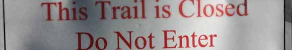 warning trailhead signs